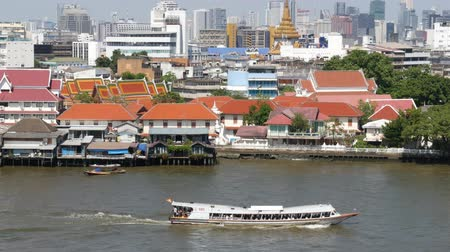 waterways : Oriental boat floating on river in Krungthep city. Modern transport vessel floating on calm Chao Praya river on sunny day in Bangkok near chinatown. Panorama.