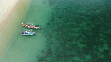 velkolepý : Fishing boats near reef. Beautiful aerial view of fishing boats floating on blue sea water near majestic coral reef. Natural exotic paradise background. Koh Phangan Samui, Thailand