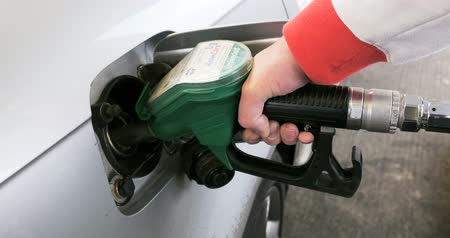 petrol : Hand refilling the car with fuel
