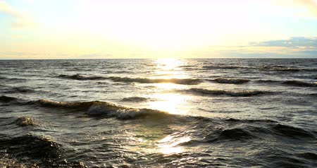 ondas : Beach scene with sun beams in the horizon , 4k