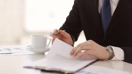 loans : man in suit and tie signing a contract Stock Footage