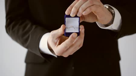 groom or salesman holding a box with wedding ring Stock Footage