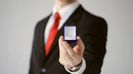 rombusz : groom or salesman holding a box with wedding ring Stock mozgókép
