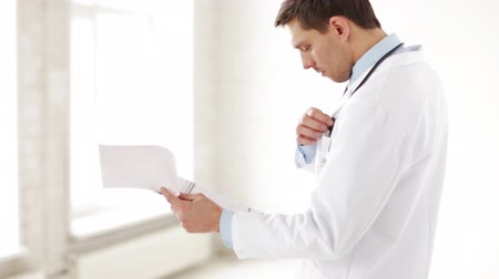 cardiological : closeup of male doctor making a prescription Stock Footage
