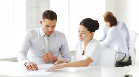 loans : business and office - man and woman signing a contract