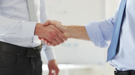 сильный : business handshake - two businessmen shaking their hands