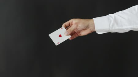 маг : magic, card tricks, gambling, casino, poker concept - man showing trick with playing cards