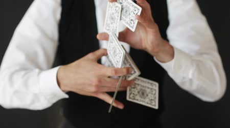 trik : magic, card tricks, gambling, casino, poker concept - man showing trick with playing cards