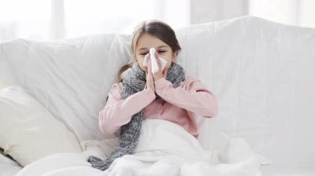 alergia : healthcare and medicine concept - ill girl with paper tissue Wideo