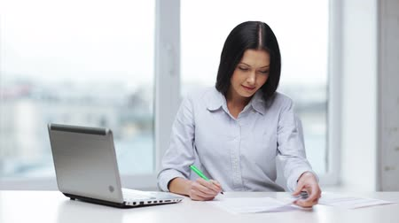 impostos : business and education concept - woman with documents and pen filling form Stock Footage