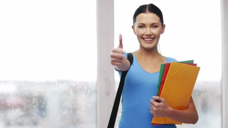 wykład : education and people concept - smiling student with bag and folders showing thumbs up Wideo