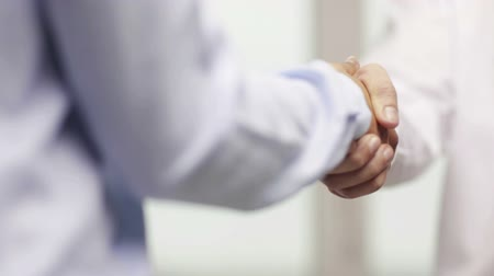 kéz a kézben : business and office concept - businessman and businesswoman shaking hands in office