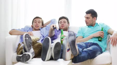 match : friendship, sports and entertainment concept - happy male friends with beer and popcorn watching tv at home
