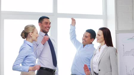 elevação : business, office, teamwork, gesture and startup concept - smiling business team doing high five gesture in office