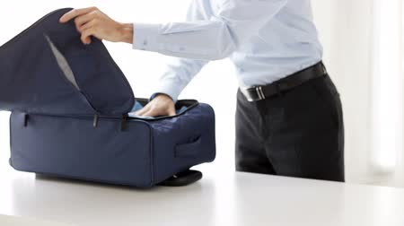 zsák : business, trip, luggage and people - close up of businessman packing clothes into travel bag