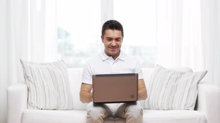 öğrenme : technology, people lifestyle and networking concept - happy man working with laptop computer at home Stok Video