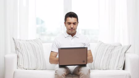 chatting : technology, people lifestyle and networking concept - man working with laptop computer at home Stock Footage
