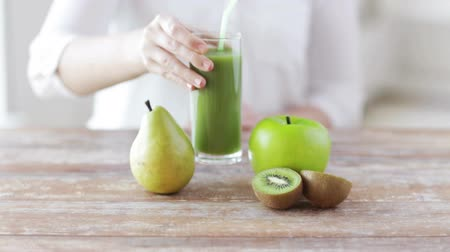 потеря : healthy eating, food, dieting and people concept - close up of woman hands with fruits and fresh juice sitting at table