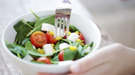salad : healthy eating, dieting and people concept - close up of young woman eating vegetable salad at home Stock Footage