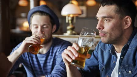 kutluyor : people toast leisure friendship and celebration concept  happy male friends drinking beer and clinking glasses at bar or pub