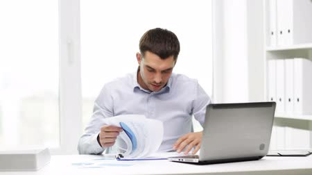 бухгалтер : business, people, paperwork and technology concept - busy businessman with laptop computer and papers working in office