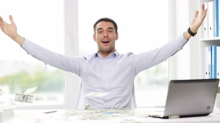 sucesso : business, people, success and fortune concept - happy businessman throwing up dollar money and sitting at table in office