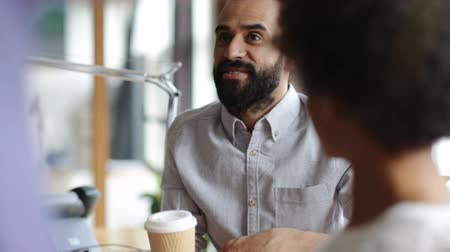 black coffee : business, friendship, leisure, communication and people concept - happy creative team or friends drinking coffee at break and having discussion in office Stock Footage