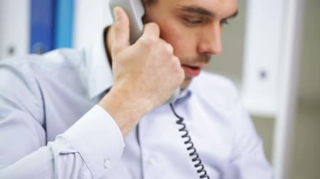 business, people, communication and technology concept - angry businessman calling on phone at office