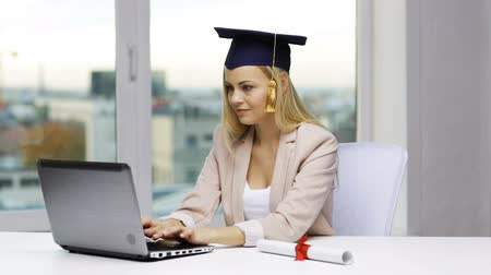 promoce : education, graduation, people, high school and technology concept - student girl or woman in bachelor cap with laptop and diploma