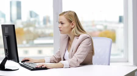 stres : business, people, stress, problem and technology concept - young businesswoman with computer typing at office