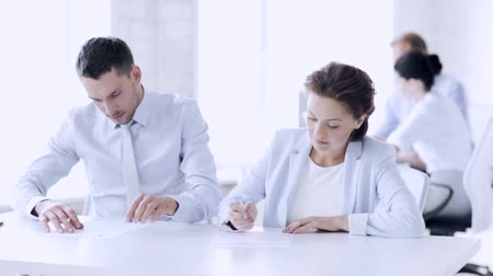 tratar : business and office - man and woman signing a contract