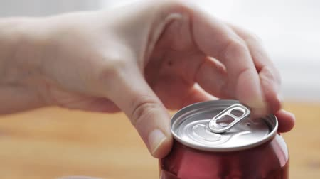 drink cans : unhealthy eating, people and drinks concept - hand opening lemonade or soda drink can Stock Footage