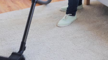 swabber : people, housework and housekeeping concept - woman with vacuum cleaner cleaning carpet at home Stock Footage