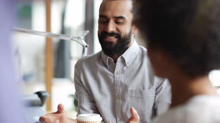 people talking : business, communication and people concept -happy creative team drinking coffee at break and having discussion in office Stock Footage