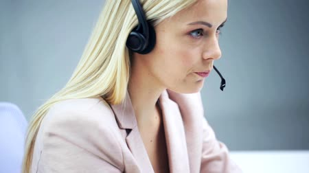 conference centre : businesswoman with headset talking at office