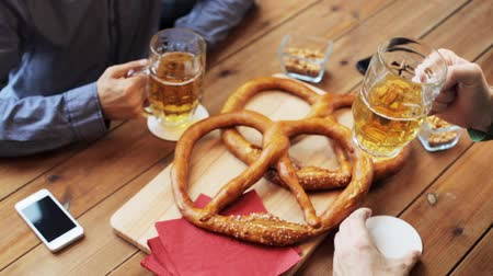 pretzel : male friends drinking beer at bar or pub