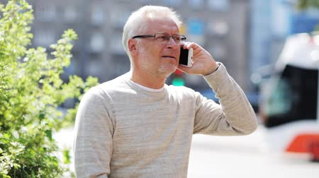 emekli : senior man calling on smartphone in city