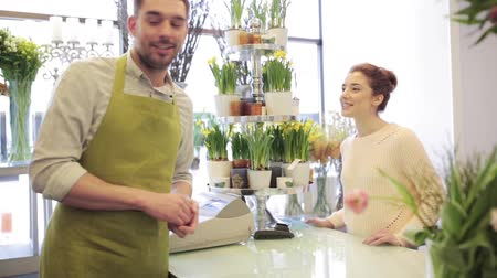 flower shops : florist showing flowers to woman at flower shop Stock Footage