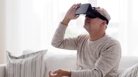 realidade : old man in virtual reality headset or 3d glasses 80