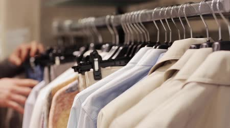 clothing : young man choosing clothes in clothing store Stock Footage