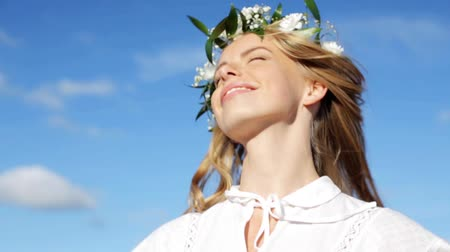 virág : smiling young woman in wreath of flowers