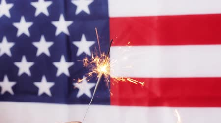 четверть : close up of sparkler burning over american flag Стоковые видеозаписи