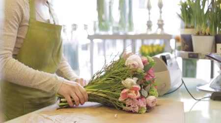 flower shops : florist woman with flowers and man at flower shop Stock Footage