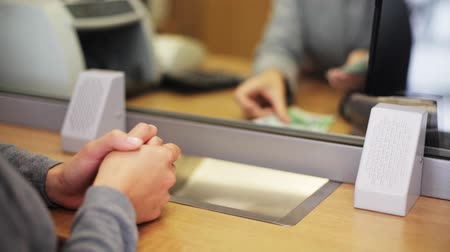 bank : clerk counting money and customer at bank office Stock Footage
