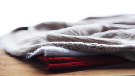 ubrania : knitwear or woolen clothes on wooden table at home