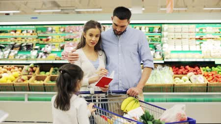 grocery : family with food in shopping cart at grocery store