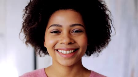 african decent : smiling african american woman touching her hair