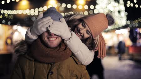 namorado : happy couple having fun at christmas market