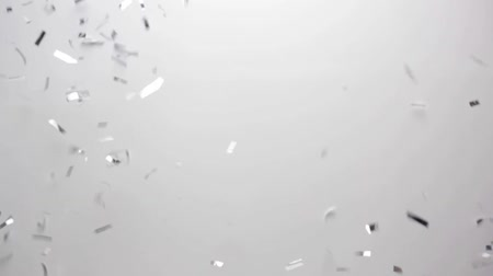ezüst : silver confetti falling over white background