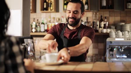 counter : man or waiter serving customer in coffee shop Stock Footage